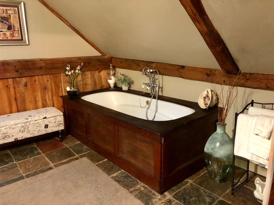 The 6ft long, mahogany tub for 2, It has a plaque that says Victoria Place, which was this house when it was a Bed and Breakfast in the 1980's. It was for sale in the barn across the street and had been buried there for years! We bought it back and it is been here since 2006.