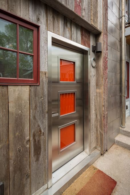 Contemporary orange, custom front door.