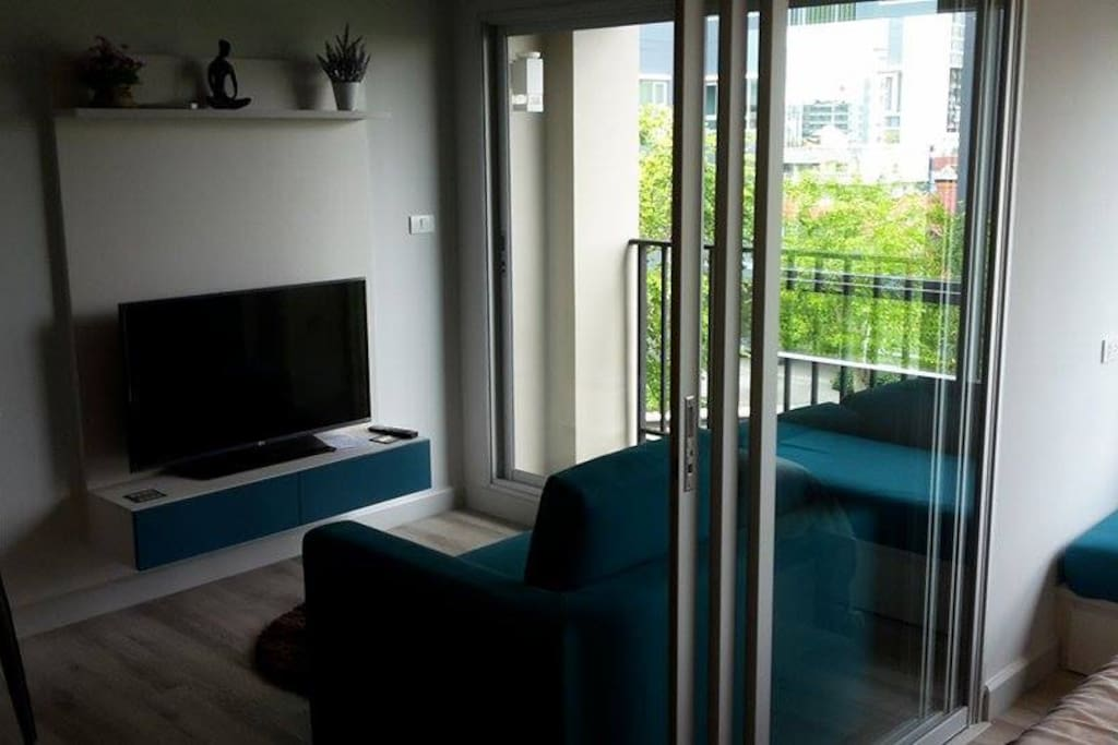 Lounge with 43 inch smart tv with true gold tv package. Sliding doors to bedroom.