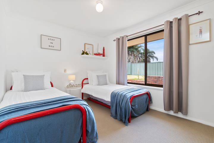 Family friendly bedroom next to the master suite, choose between the two top single mattresses or the toddler safe floor slide out trundle beds.