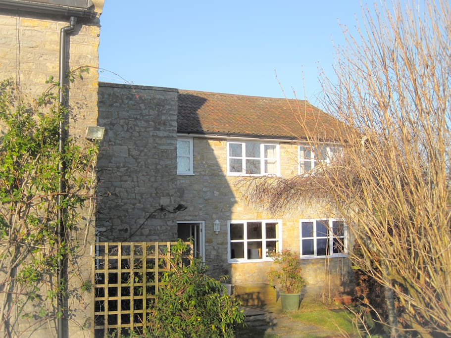 The modern east wing of Old Westbrook Farm has 2 bedrooms, kitchen and study