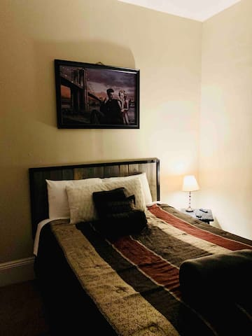 Bedroom 1 with Fulll and Single Bed.  Smart TV in room. FREE WIFI
