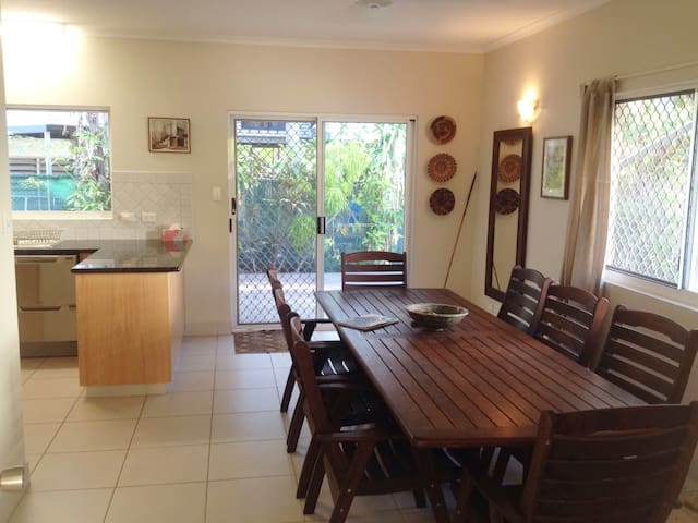 Dining area with 8 seater dining table.