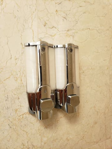 Shampoo & Conditioner Dispenser in all the showers