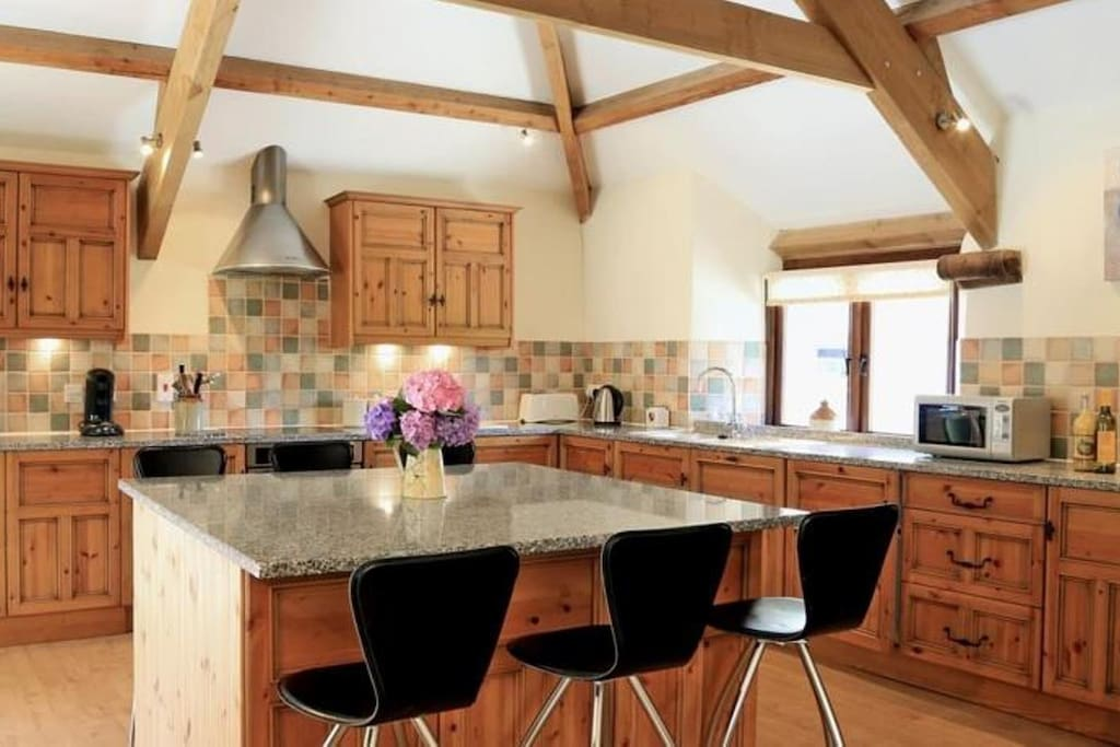 Large kitchen with granite worktops and island