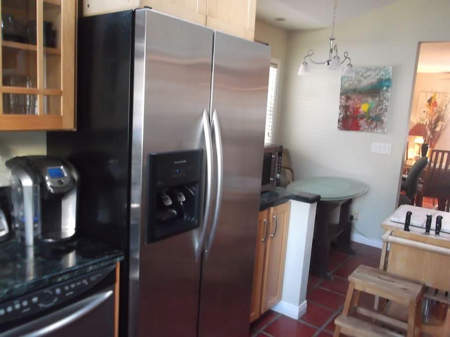 Kitchen stainless Kitchenaid  refrigerator and Kuerig coffee maker.