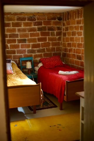 Fourth bedroom in the basement with two single beds
