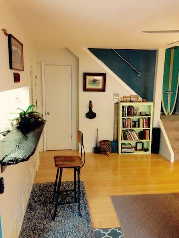 Downstairs living room (ground floor), reclaimed barnwood work/coffee bar