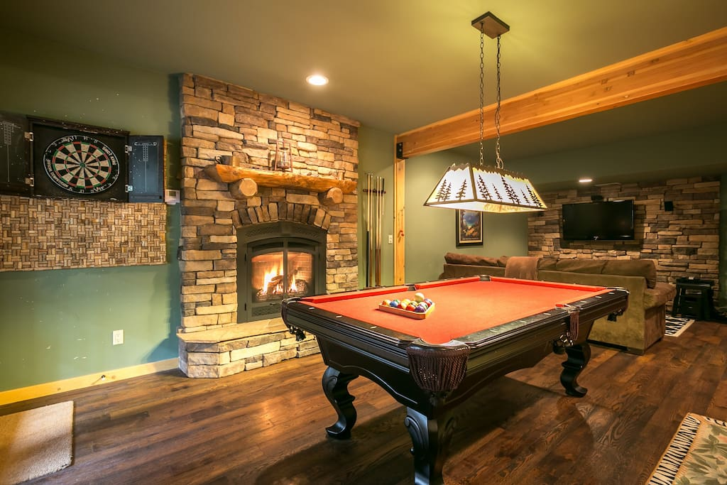 Play pool or darts by the gas fireplace