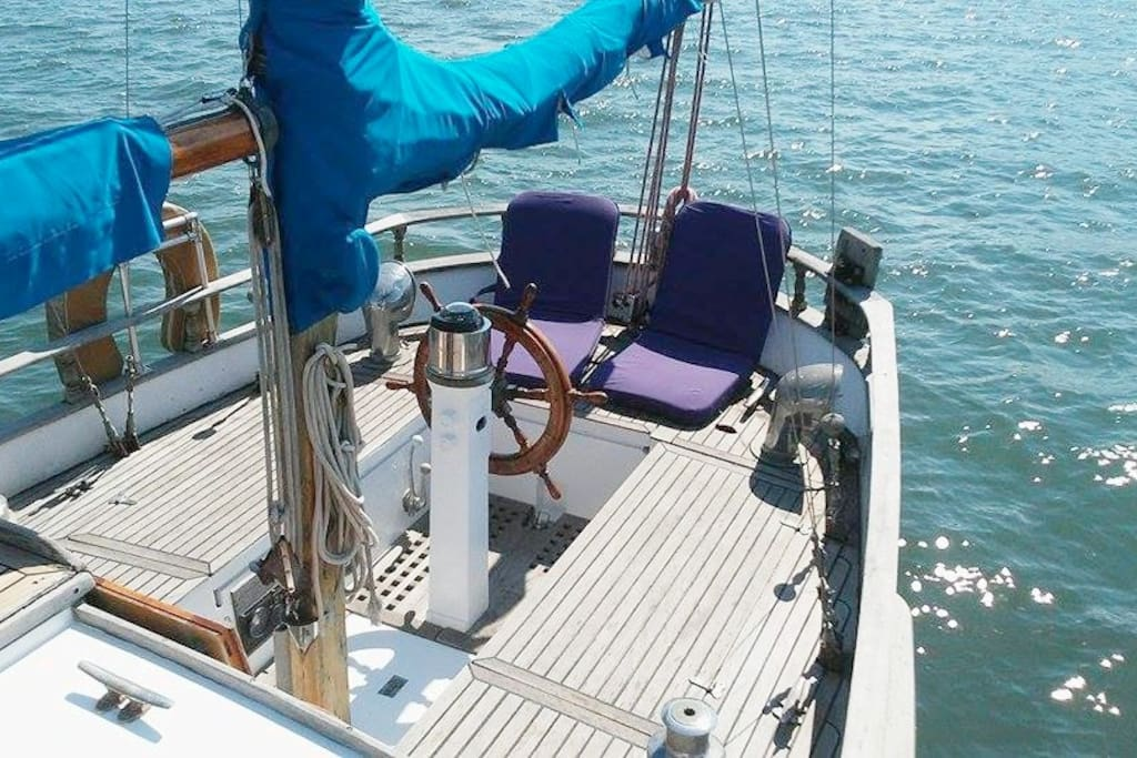 A spacious cockpit perfect for sunbathing after a swim, picnicing, entertaining guests, and cuddling.. relax and lay out on these beautiful teak decks~