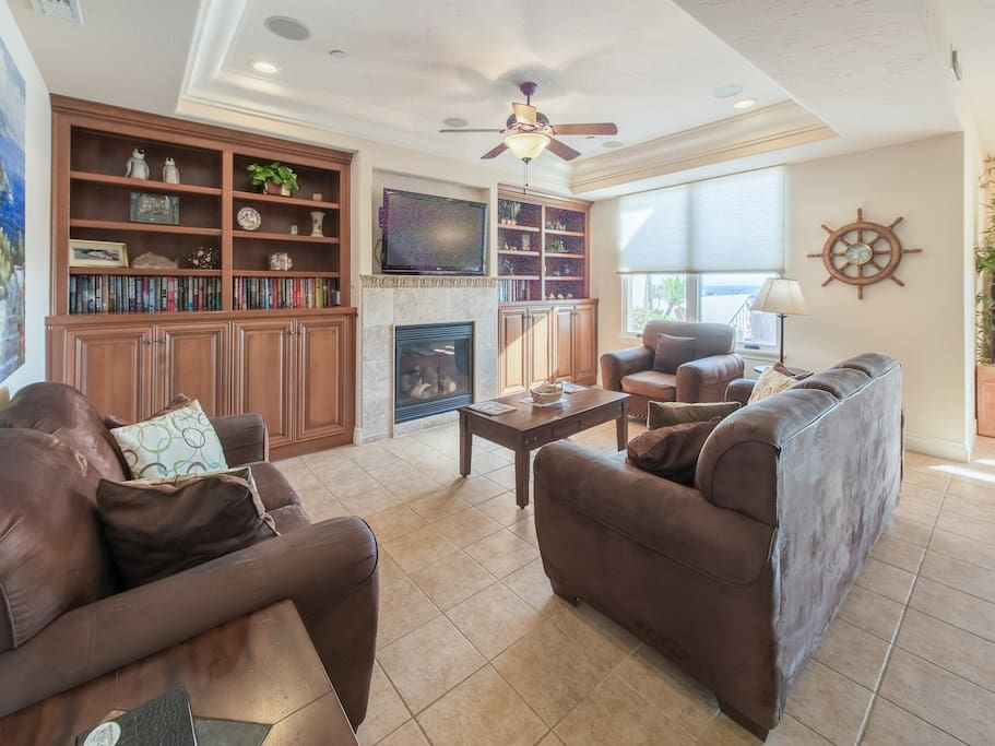 Tiled floors and ample natural light fill the living room.