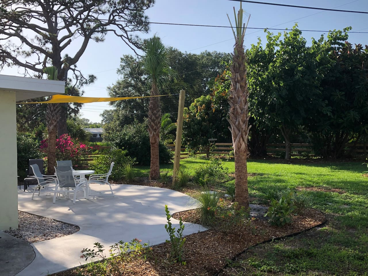 Made in the shade!  We are all about outdoor living.  Enjoy the big patio with shade sail in the tropical completely fenced back yard (wood farm fence, metal fence backer material covers ground to top 4').
