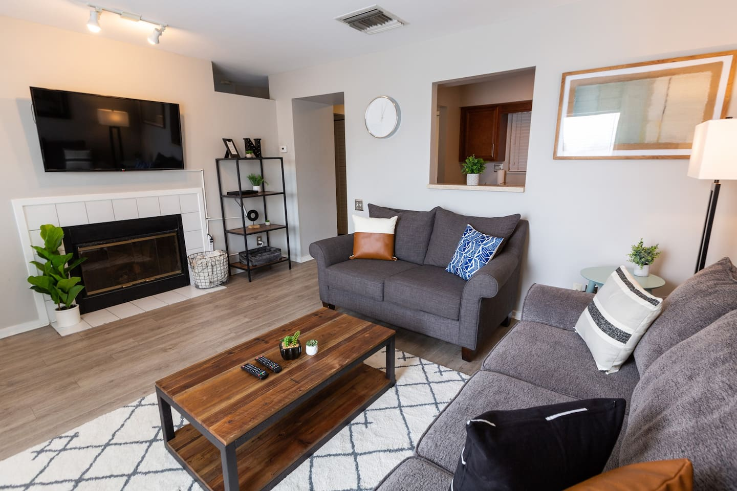 """Come stay in our stylish, comfy living room! Equipped with a 50"""" smart TV,  loveseat, pull-out sofa, and your own private balcony with a great view of the river!"""