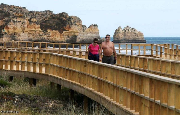 Alvor wood walkway. You can enjoy a lovely walk for more than 4 miles along the beach and the estuary