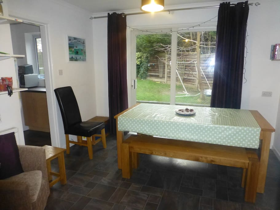 Extra dining area with patio doors to the garden