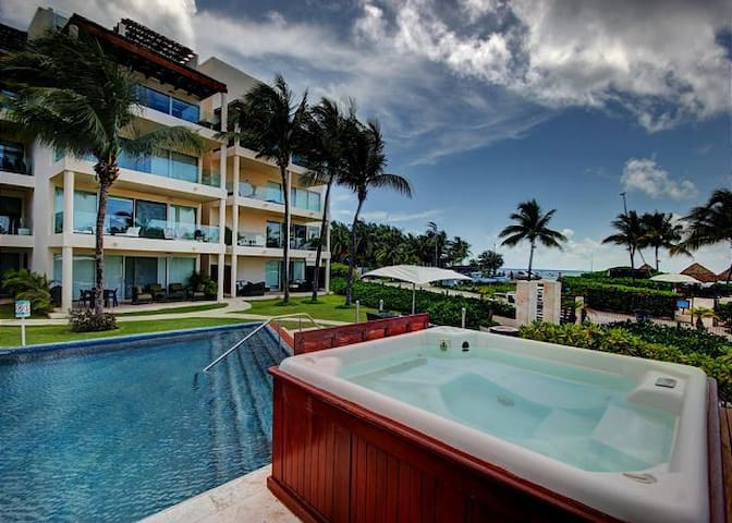 Ocean view condo for 5 Private beach area and gym!