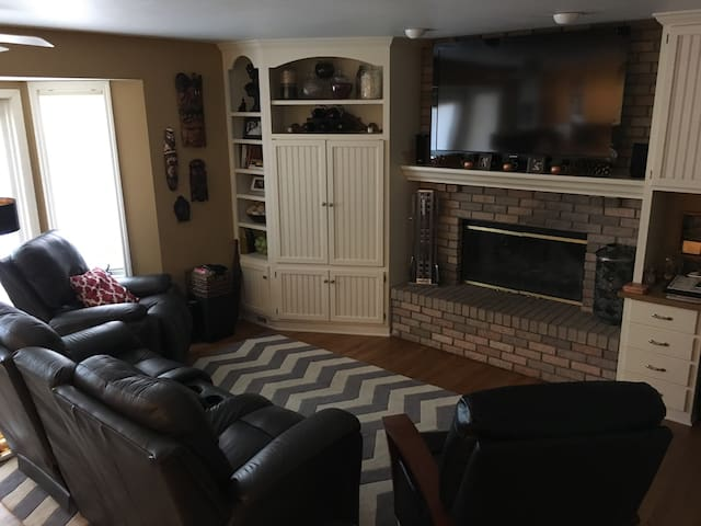 Family room adjacent to kitchen with attached deck