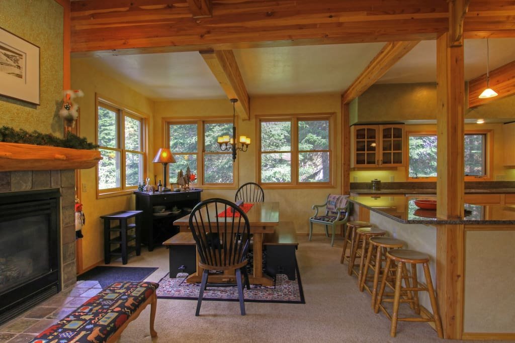 Large dining area nestled in amongst alpine firs and pine trees.