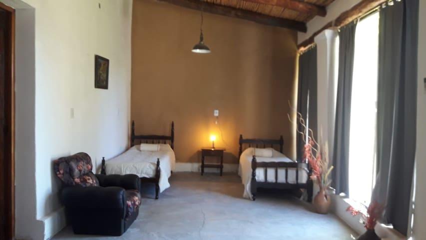 Camas singles en el segundo dormitório que es parte de la habitación Cerro Azul.