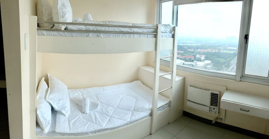 Connecting rooms with a view of Katipunan Avenue