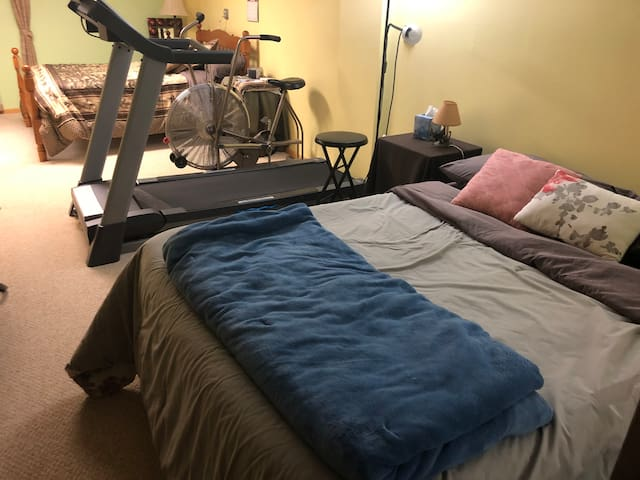 Full size bed in second bedroom. Exercise equipment