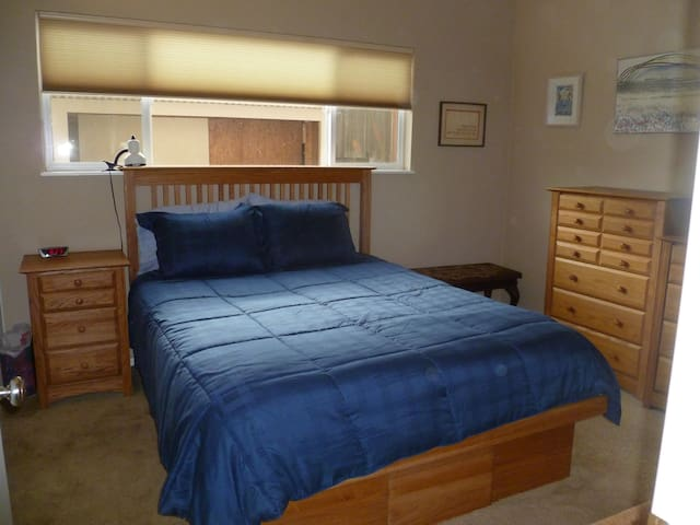 master bedroom with queen bed and attached bathroom
