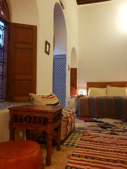 Comfortable bed in airy room.