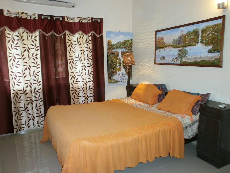A Bedroom  with large Queen size double bed for single or for couple occupancy. Spacious  split level Panasonic a/c. Attached 5 star bathroom.