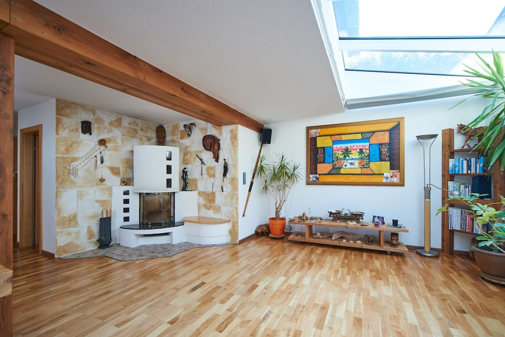 Wohnzimmer mit Kamin/ Living room with fireplace