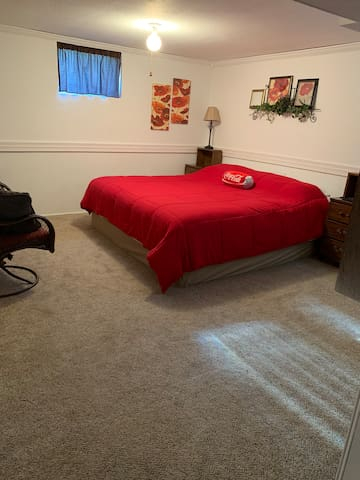 Extra large bedroom with a king size bed and TV!!