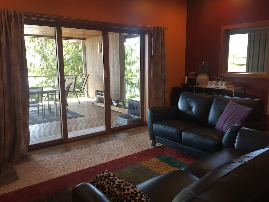 The living room faces due south and opens onto a private deck