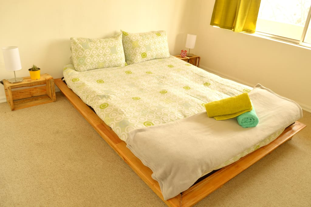 Double bed, with towels provided.