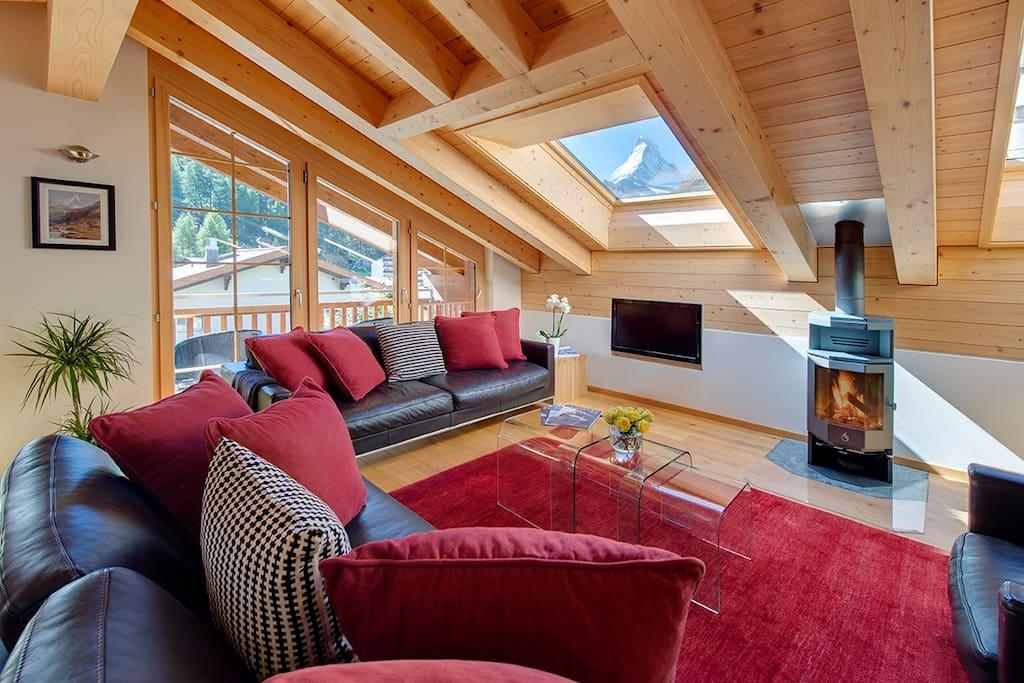 Wood burning fire and Matterhorn view through skylight