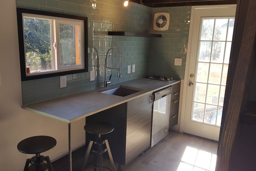 Full Kitchen with Dishwasher, Disposal, 2 Burner Cooktop, and seating for 2