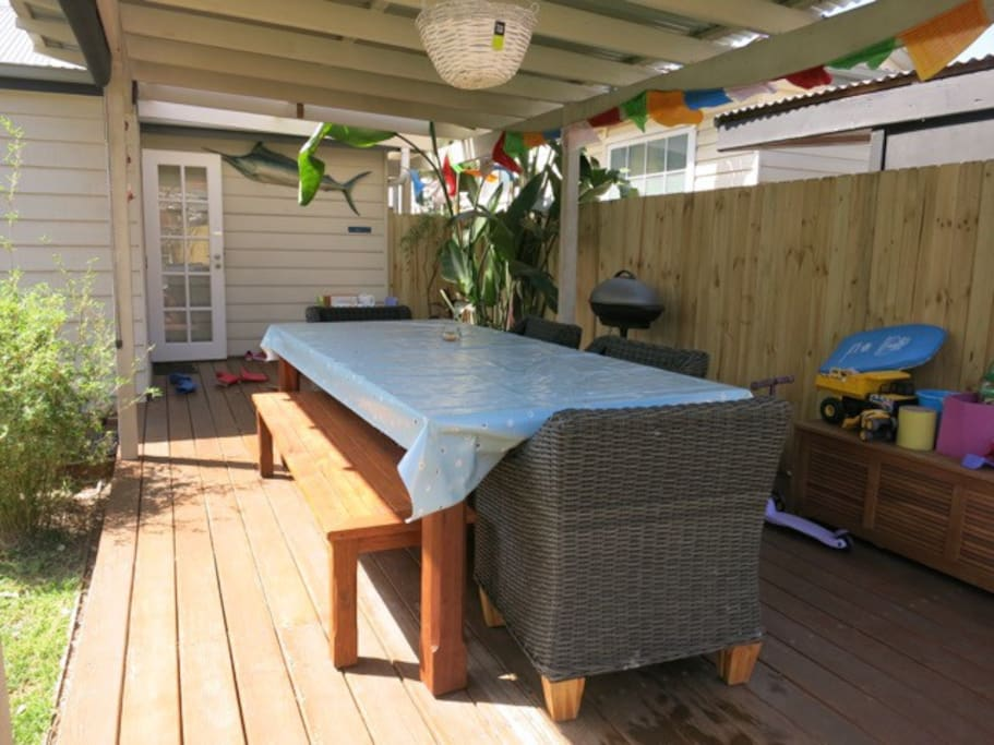 Large covered outdoor dining, perfect for summer BBQs