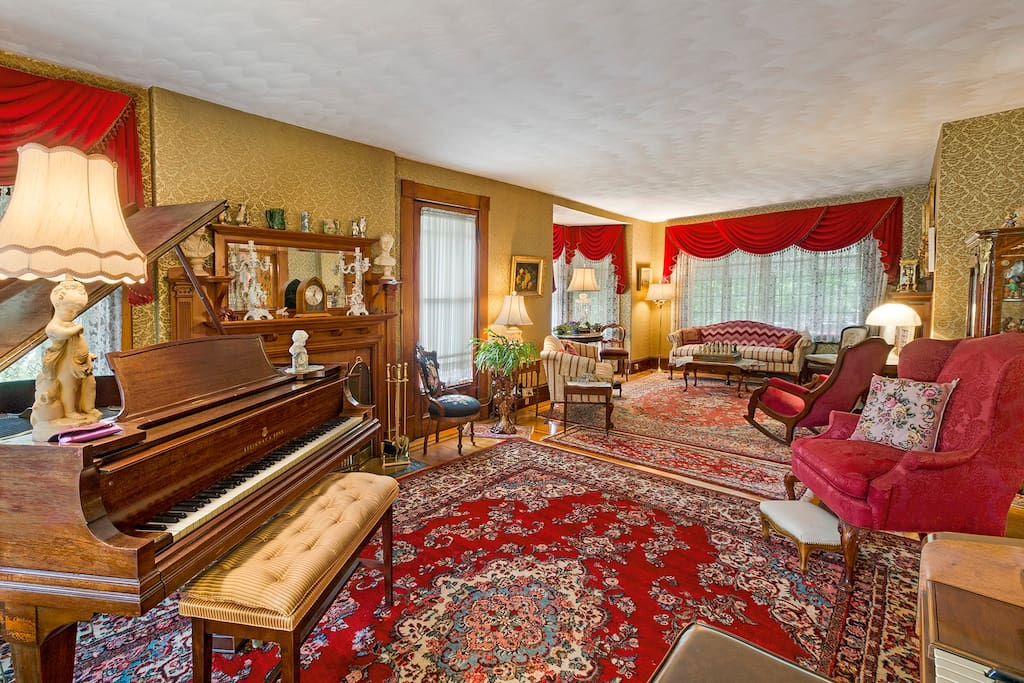 Relax in our living room.  Complete with two fireplaces and a grand piano.