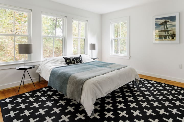 Master bedroom with queen-size bed, ensuite bathroom, and large closet with hanging and shelf storage so that extra swimsuit or sweater has a place to call home