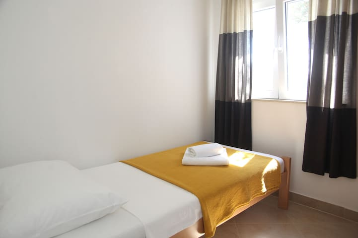 Bedroom 1 with one bed- ground floor apartment