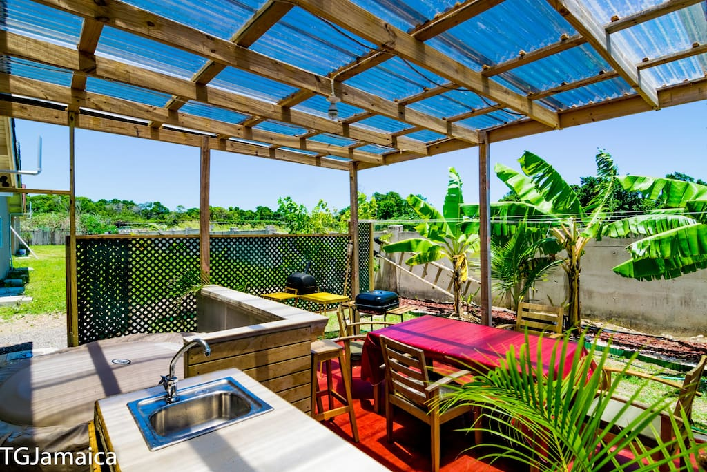 Sit in our tropical backyard surrounded by the banana and palm trees,  BBQ on one of our 2 BBQ grills and with seating for 8 the gang is all welcomed