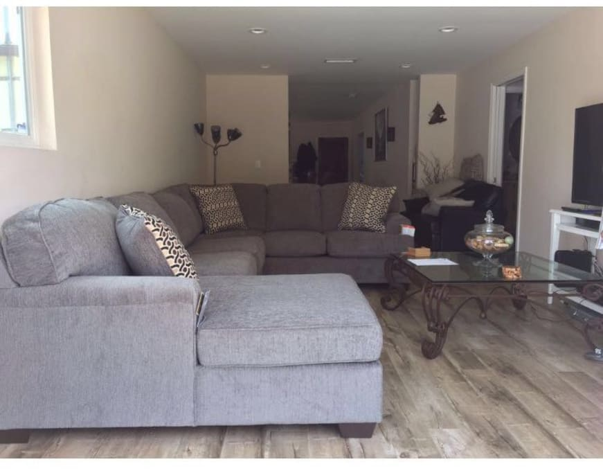 Spacious living room with sectional couch and flat screen TV