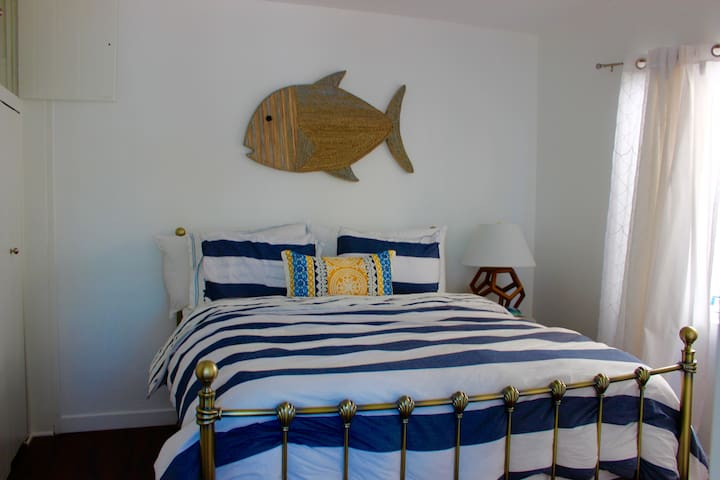 Bedroom with comfy queen size bed.