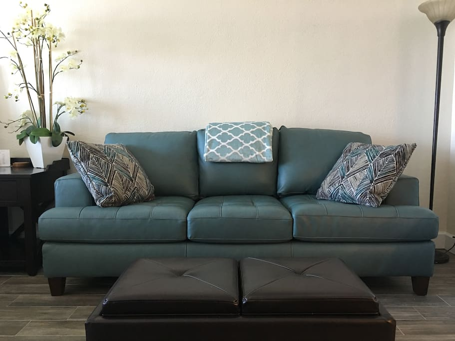 Plush leather queen size couch for your seating comfort.  It also opens up as a sleeper with a upgraded memory foam mattress.