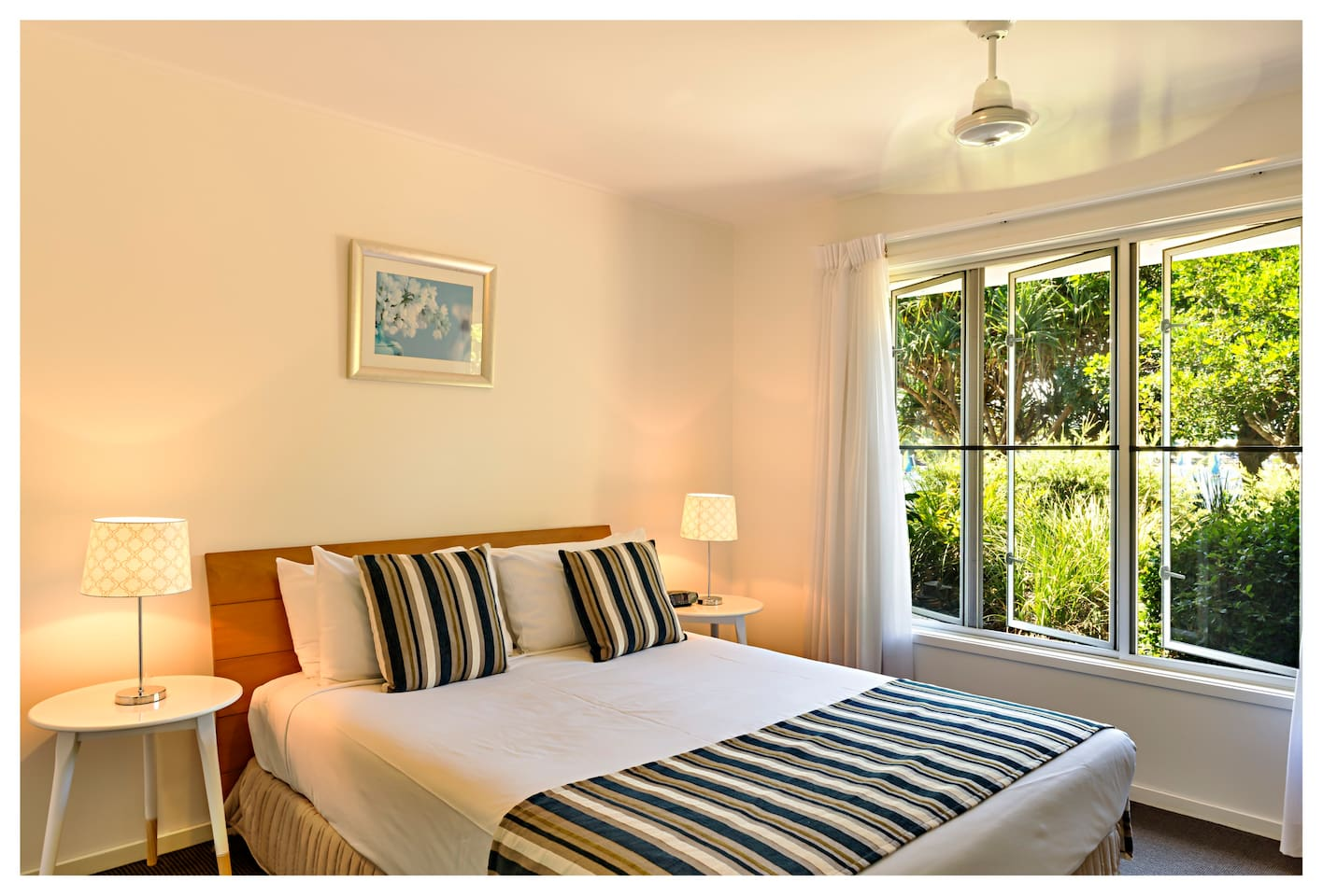 The Master Bedroom features a Television air-conditioned, is light airy with full Lagoon Views