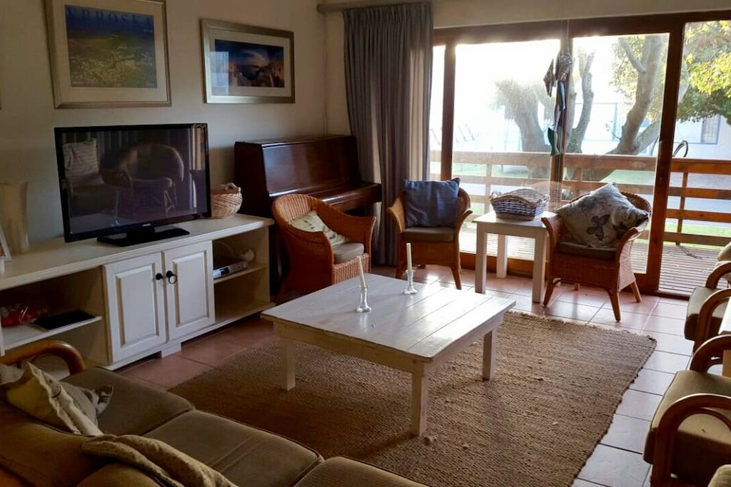 Livingroom with DSTV and balcony to watch your kids  in cul de sac