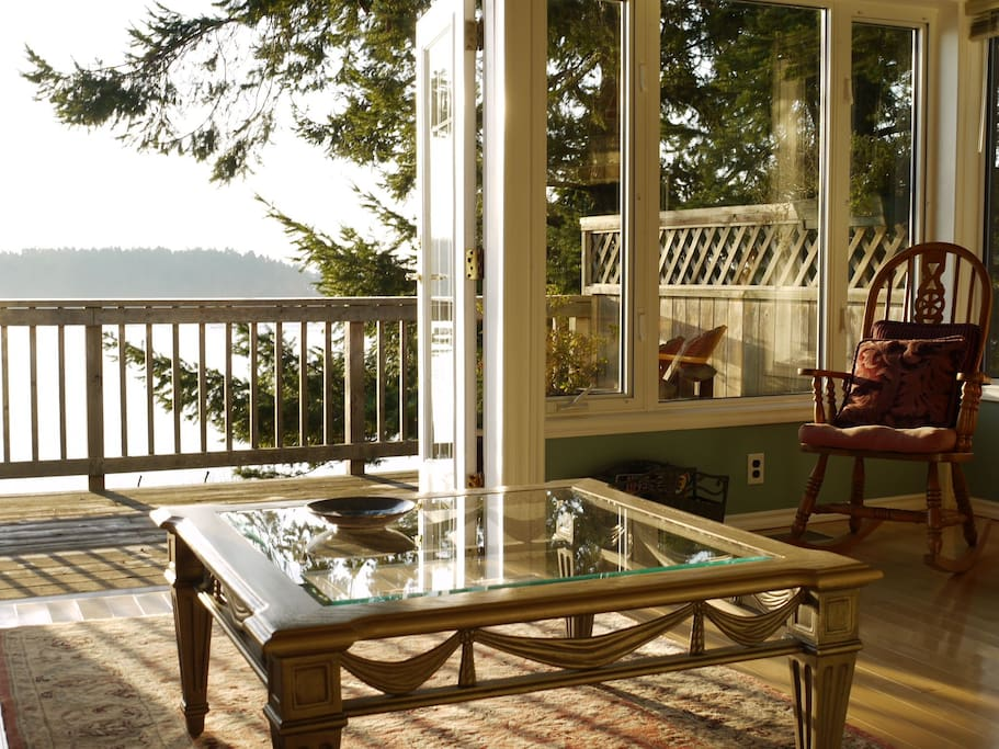 The modern living room with its southern exposure, is bathed in sunshine all day.