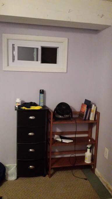 Dresser, bookshelf, window