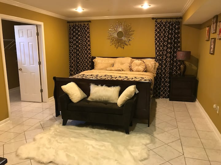 Cozy king size bedroom in basement apartment