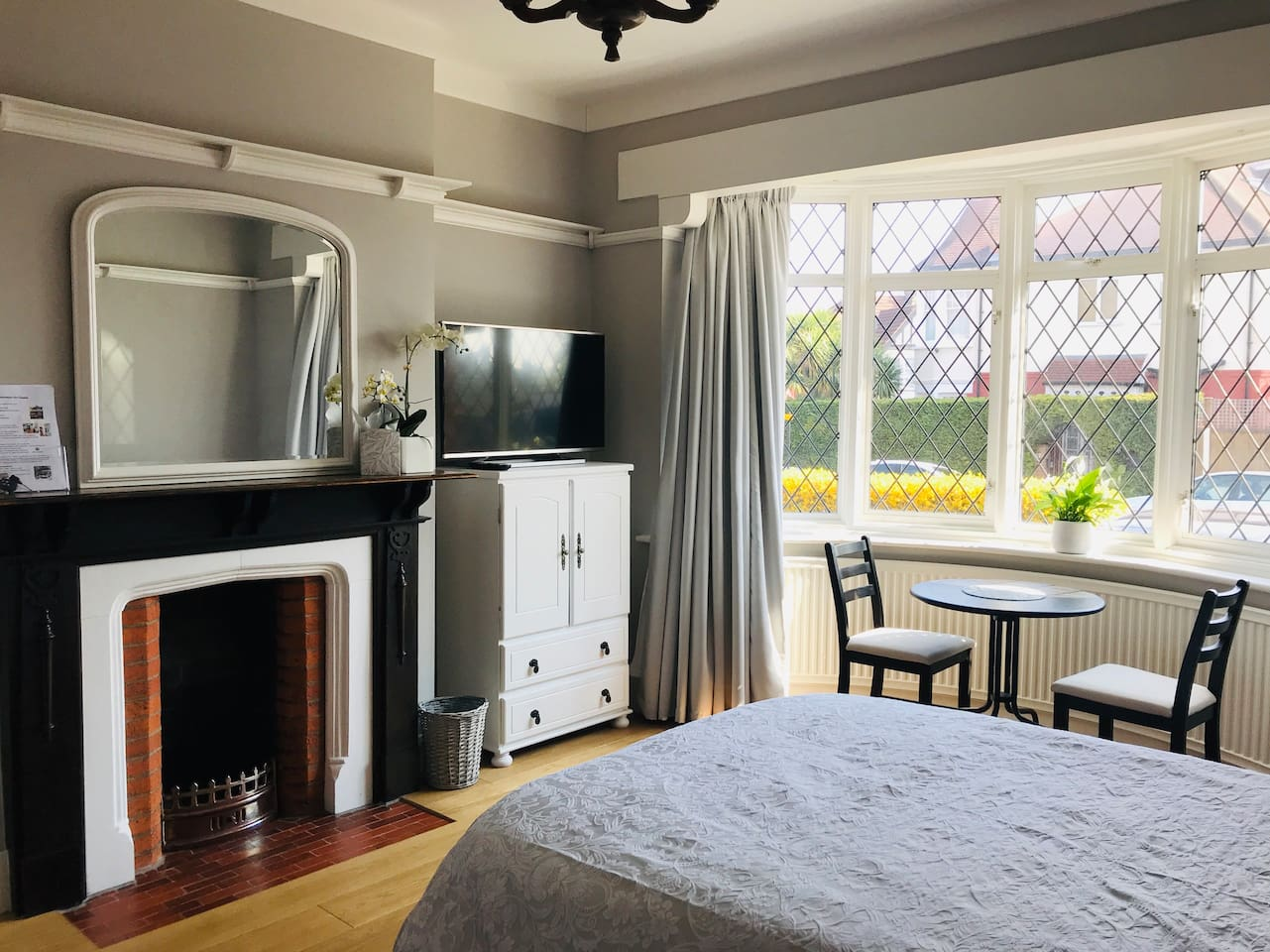 Large, bright and clean bedroom with seating and dining area, located on the ground floor. It is near the front entrance of the property so it feels very private - you don't have to walk through the rest of the house to get to your room.