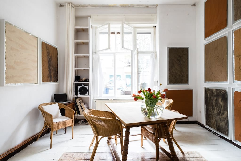 """Lots of light in your room! Curtains and shutters (handle with care - they are 100 years old!) give you privacy. But with open windows you are directly connected to our """"street terrasse"""" for brunch, coffee, or a glass of wine."""