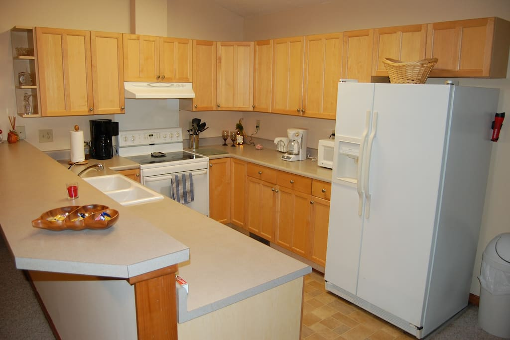 Well equipped kitchen with two coffee makers, microwave, toaster oven, dishwasher and smooth top stove